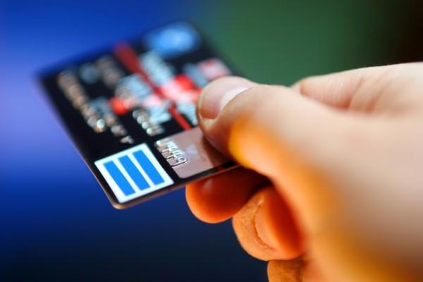 Hand receiving credit card